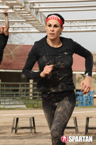 amirra besh runs through mud spartan race