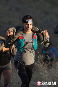 amirra besh carrying sand bags in spartan race